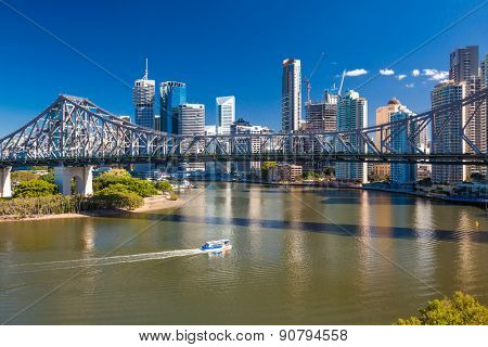 BRISBANE, AUS - MAY 12 2015: Brisbane Skyline with story bridge and the river. It is Australias third largest city, capital of Queensland.