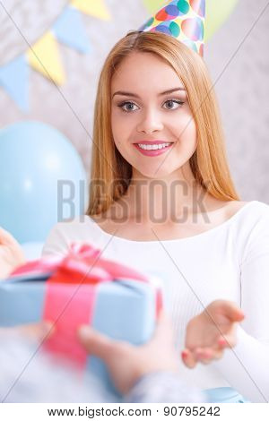 Young girl receives birthday gift