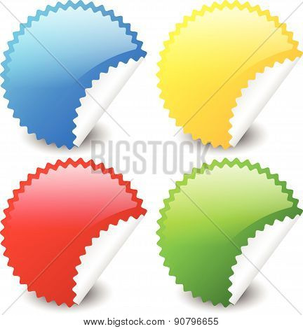 Starburst Shapes As Stickers In 4 Colors, Blue, Yellow, Red And Green. Peeling Stickers.