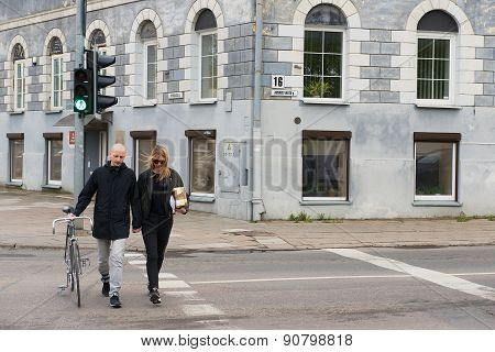 People cross the road at the traffic light in Vilnius, Lithuania.