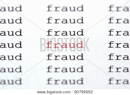 Typewritten Word Fraud In Red On White Paper