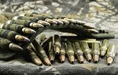 pic of hollow point  - camouflage ammunition belt for rifle on camouflage background