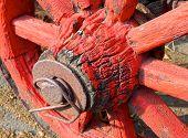 stock photo of wagon wheel  - The closeup of antique wagon wheel at farmhouse  - JPG