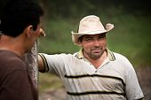 image of vaquero  - Handsome male ranch hands on dairy farm in Costa Rica - JPG
