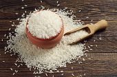 pic of cereal bowl  - Bowl full of white rice and scoop on dark wooden table - JPG