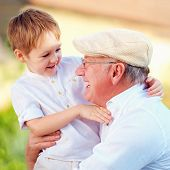 foto of grandpa  - portrait of happy grandpa and grandson having fun outdoors - JPG