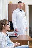 pic of infirmary  - girl checks sight at the reception of an ophthalmologist - JPG