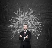 stock photo of microchips  - Handsome information technology specialist is thinking about optimisation of the business process - JPG