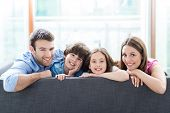 foto of sofa  - Family relaxing on sofa - JPG