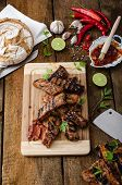 foto of baby back ribs  - Ribs in spicy marinade with chilli honey and beer - JPG