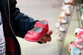 pic of shoe  - Father on market or in shoe shop choosing new footwear to his child - JPG
