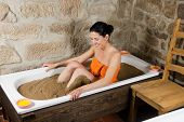 foto of loam  - Woman in bath with clay  - JPG