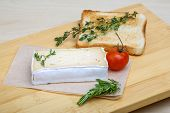 foto of brie cheese  - Soft brie cheese with rosemary thyme and toast bread - JPG