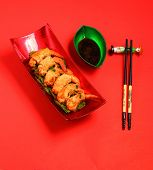 stock photo of deep  - traditional Vietnam deep fried shrimp and pork rolls in breadcrumbs served on an orange background - JPG