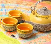 picture of ceremonial clothing  - Asian style tea set on a Vietnamese table cloth - JPG