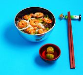 pic of rice noodles  - Vietnamese shrimp and rice noodles soup pho with a blue background - JPG