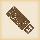 foto of usb flash drive  - Grungy brown icon with image of usb flash drive - JPG