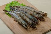 stock photo of tiger prawn  - Raw tiger shrimps on the wood board - JPG