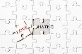 pic of hate  - Missing jigsaw puzzle piece with word LOVE covering text HATE - JPG