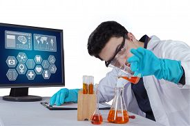 image of chemical reaction  - Young scientist doing experiment in the laboratory and make chemical reactions - JPG