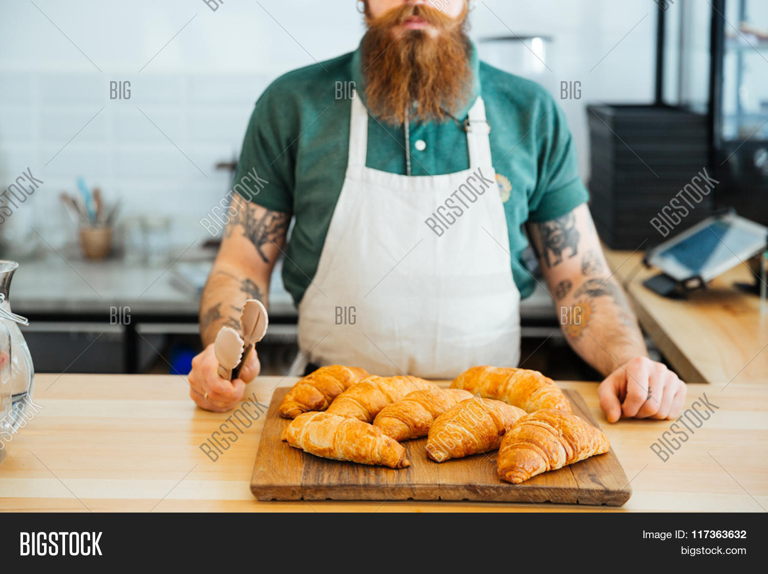 White apron cafe - Closeup Of Bearded Man In White Apron With Tattoo On Hands Standing In Cafe And Holding