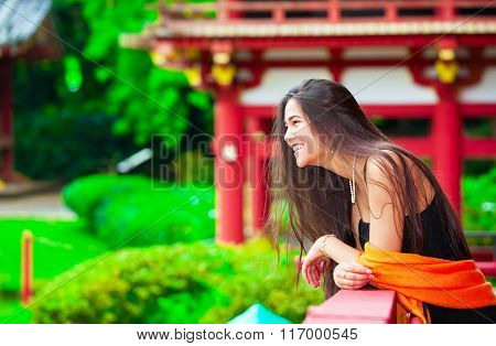 Teen Girl  At A Red Japanese Or Chinese Bhuddist Temple