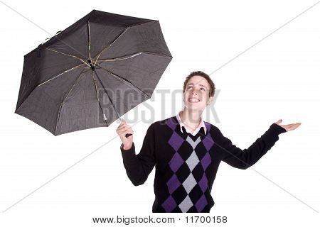 Young Boy Bypassing The Umbrella, Open Arms Looking Up, Isolated On White, Studio Shot