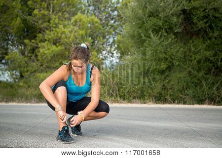 Girl Tying Her Shoes