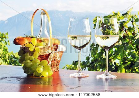Wine, grapes and bread against Geneva lake, Lavaux region, Switzerland