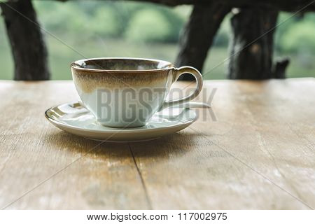 Soft Focus On Cup Of Coffee On Wood Table
