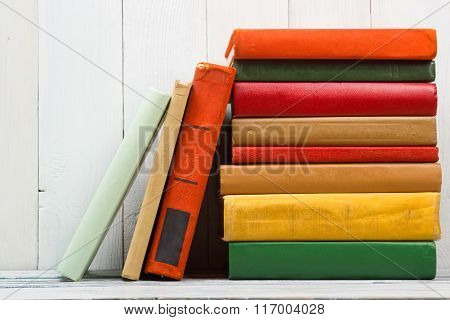 Stack of books on wooden table. Back to school. Copy space