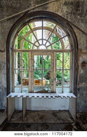 window in old abandoned hotel in former Tourist Complex of Kupari village Croatia