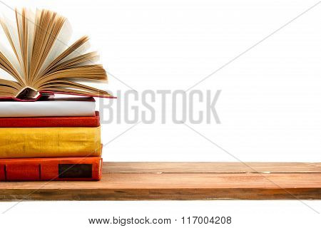 Open book, hardback books at wooden shelf isolated on white background. Back to school. Copy space f