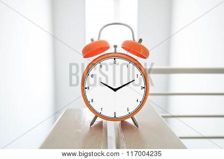 Alarm clock, decoration in white interior space