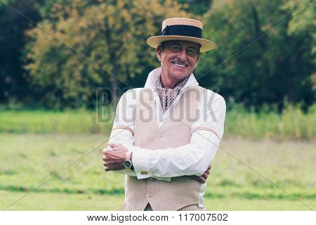 Smiling Senior Man In Suit And Hat Enjoying His Estate.
