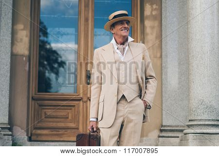 Smiling Retro Dandy Standing At Front Door Of His Mansion.