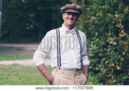 Smiling Senior Vintage Fashion Man Enjoying His Garden.