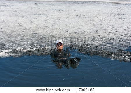 The Woman Accepts The Curative Mud Baths On Lake Elton.