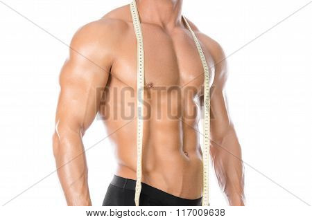 Bodybuilding And Sports Theme: Handsome Strong Bodybuilder Holding Centimeter Tape To Measure Body I