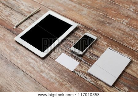 close up of notebook, tablet pc and smartphone