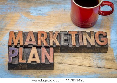 marketing plan  - word abstract in vintage letterpress wood type blocks stained by color inks