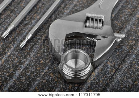 Wrench, Plumbing Fitting And Screwdriver