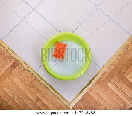 Washbasin With Sponge On The Floor