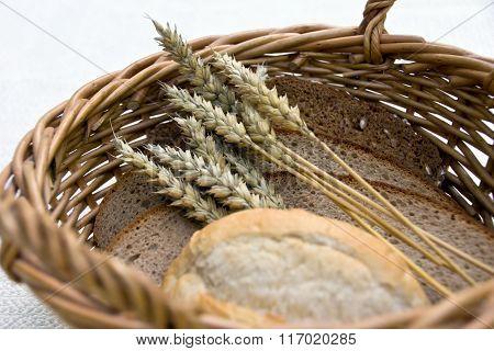Bread and rolls in wicker basket
