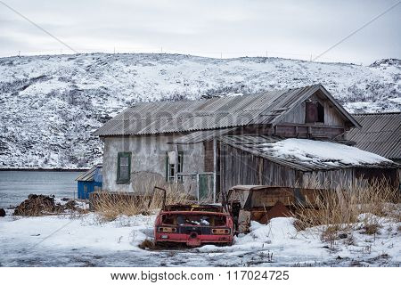 The Old Wooden Houses And The Remains Of Rusty Cars,  Arctic, Barents Sea, The Village Of Teriberka