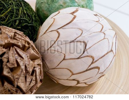 Decorative Paper Balls On A Wooden Tray