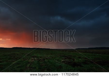 Sunset And The Dramatic Rain Clouds Over Countryside Landscape. Autumn In Latvia.