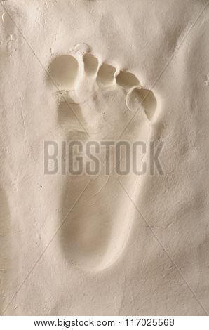 Baby Foot On Plaster