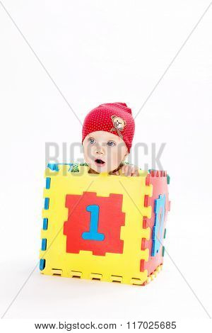 little child baby isolated on white background studio shot 1 year playing numbers sitting in the box