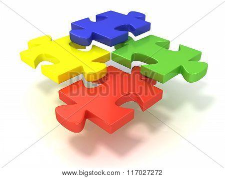 Four colorful jigsaw puzzle pieces set apart